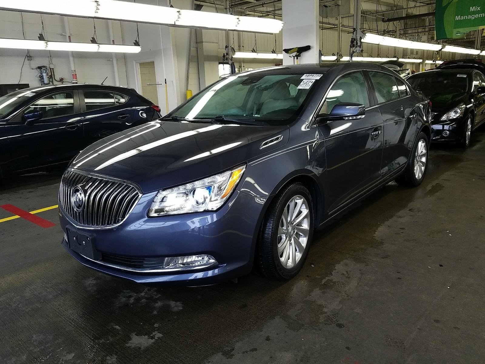 Buick LaCrosse: Folding Mirrors